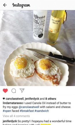 Screenshot of an Instagram photo containing two fried eggs and containers of canola oil in the background.