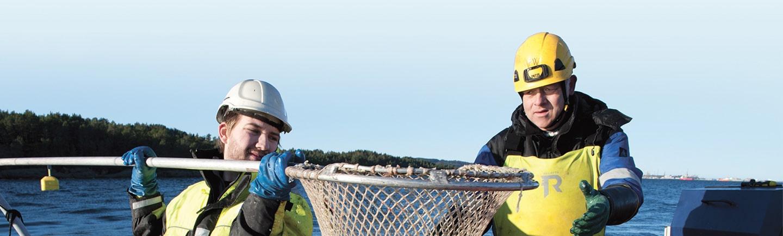 Two men inspecting a fishing net