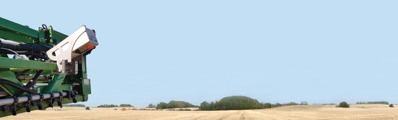 Crop sprayer in a field