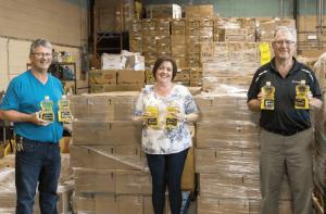 Food Bank staff receive SaskCanola's oil donation from director Doyle Wiebe